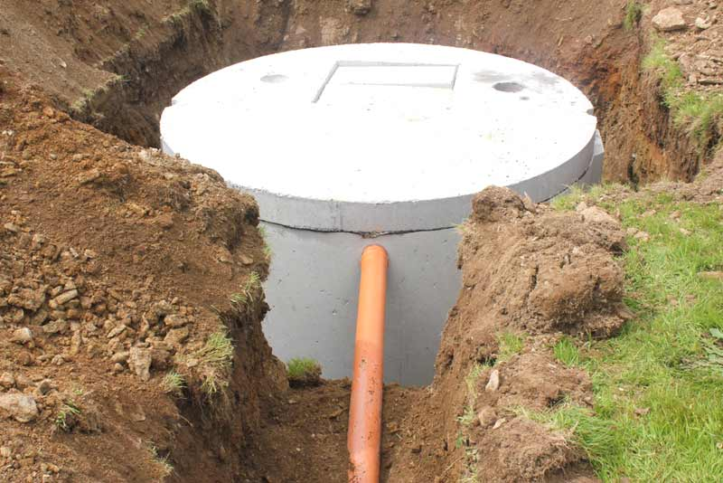 Septic tank in hole with cover